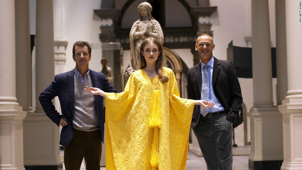 Peers (left), a textile expert, and fashion designer Nicholas Godley (right) with a model wearing their cape. The garment will be on display until June.