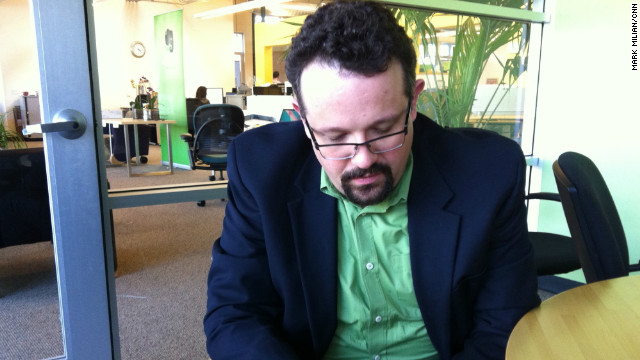 Evernote CEO Phil Libin inputs data into Hello, an app he hopes will replace address books.