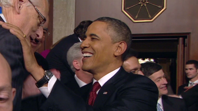 Obama enters the House chamber