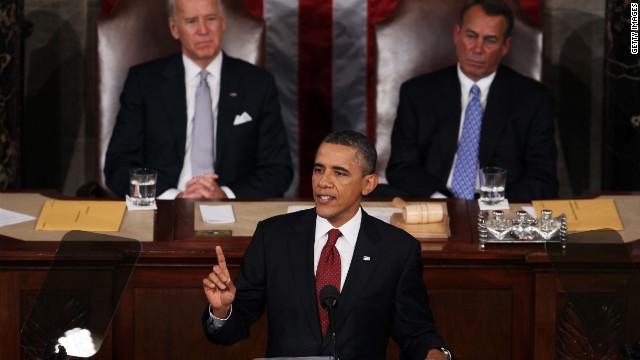 President Obama, flanked by Vice President Joe Biden and House Speaker John Boehner, gives the State of the Union address .