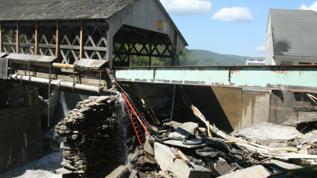 Vermont bridge severely damaged during the flash flooding of the Ottauquechee River.