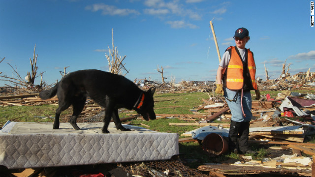A search team looks for possible victims from the tornado that hit Joplin, Missouri, in May of 2011.