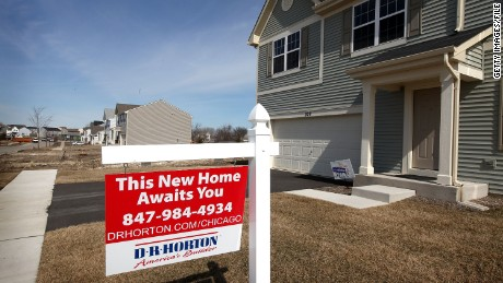 VOLO, IL - MARCH 16:  A spec home is offered for sale in a housing development on March 16, 2011 in Volo, Illinois. Request for building permits in February, a leading indicator for the strength of the housing industry, fell 8.2%, to a seasonally adjusted 517,000 units, a record low. Single-family home construction starts dipped nearly 12% in the same month and multi-family starts fell 46%.  (Photo by Scott Olson/Getty Images)