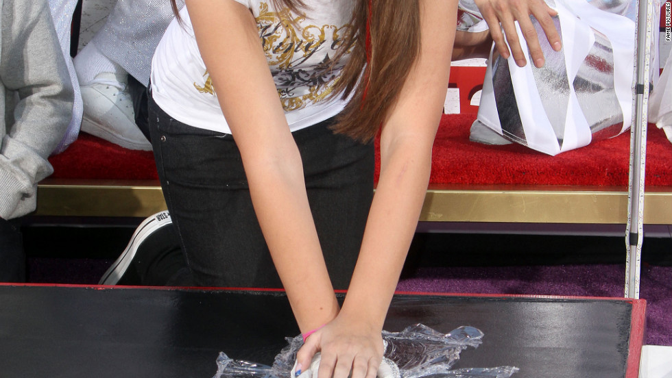 Paris Jackson uses Michael Jackson's glove for the hand and footprint ceremony in Hollywood.