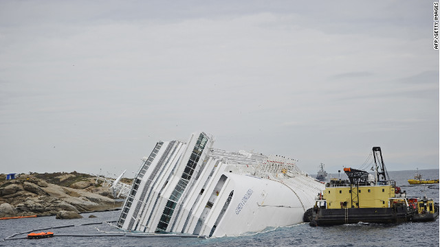 Technicians work Friday near the wrecked ship Costa Concordia in front of Giglio island.