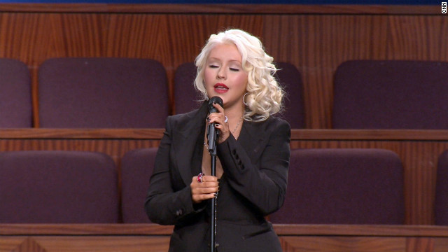 "Christina Aguilera sings Etta James' signature song ""At Last"" Saturday at the funeral in Gardena, California."