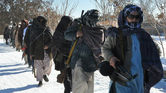 Taliban fighters pictured after joining Afghan government forces for a ceremony in Ghazni province on January 16.