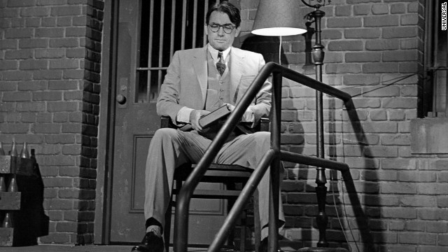 Atticus Finch sits outside the jailhouse to protect Tom Robinson in the movie version of To Kill a Mockingbird