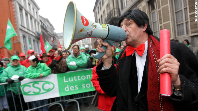 A man dressed as Belgian Prime Minister Elio Di Rupo takes part in a strike in front Di Rupo's residence in Mons, on January 30, 2012.