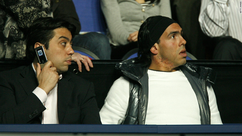 Stein believes Tevez's potential move away from City has been complicated by the amount of interested parties involved in negotiations. Here Tevez is pictured alongside his representative, Israeli businessman Kia Joorabchian.