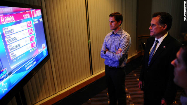 Republican presidential hopeful Mitt Romney (R) watches primary election resukts with his son Josh during a primary election night event in Tampa, Florida, January 31, 2012. AFP PHOTO/Emmanuel Dunand (Photo credit should read EMMANUEL DUNAND/AFP/Getty Images)