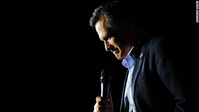 Republican presidential hopeful Mitt Romney sings 'America the Beautifull' while holding a campaign rally at Lake Sumter Landing in The Villages, Florida, January 30, 2012.