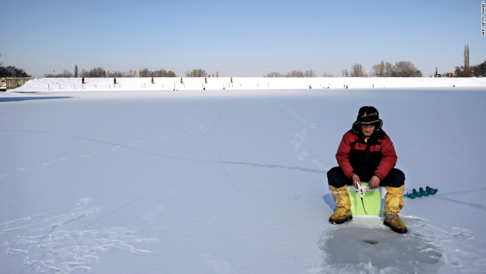 An ice fisherman waits for a catch on a frozen lake near Sofia on January 30.