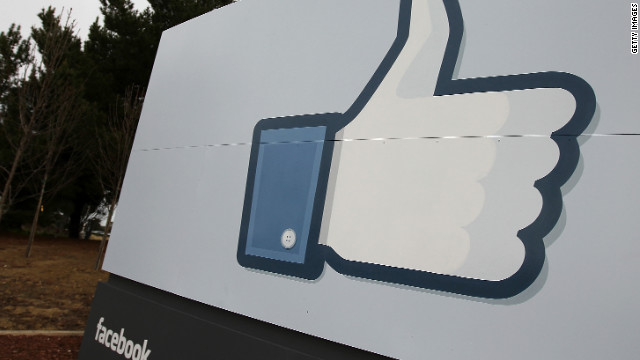 "A sign at  Facebook's headquarters in Menlo Park, California, shows the ""like"" icon."
