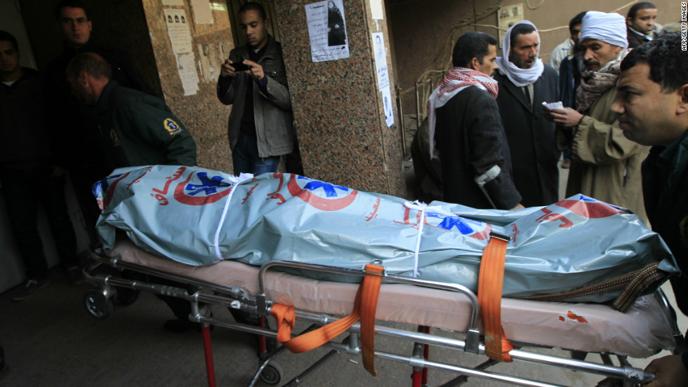 Egyptian medics wheel the body of a victim into a morgue in Cairo on February 2, 2012.