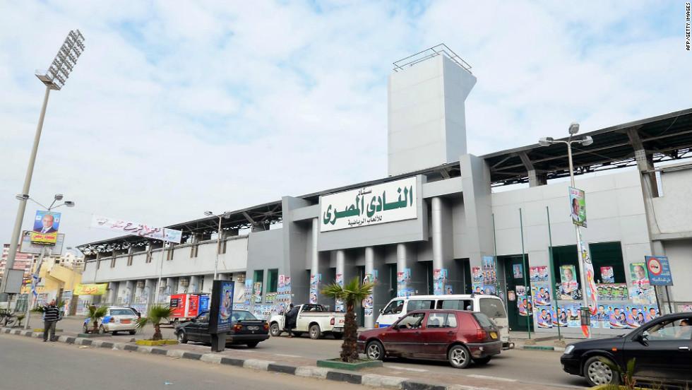 Egyptians drive past Port Said Stadium, home of Al-Masry, on February 2, 2012.