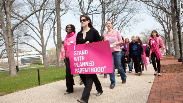 Planned Parenthood supporters walk to a rally on Capitol Hill on April 7, 2011.