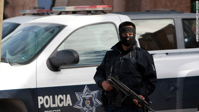 A police officer guards one of the hotels where policemen are billeted on January 31 in Ciudad Juarez, Mexico.