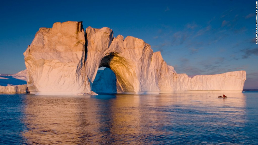 Tour boats edge by icebergs floating in the fjords of Disko Bay even in the summer.