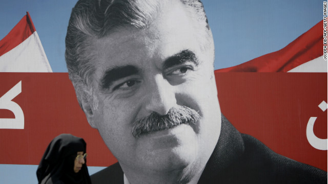 A woman walks past a portrait of slain Lebanese former premier Rafiq Hariri displayed near his gravesite in Beirut on August 19.