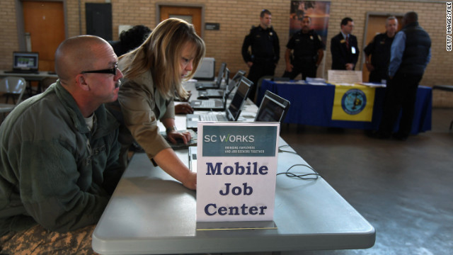 COLUMBIA, SC - JANUARY 19: Workforce case manager Christel Forrest assists Spc. Matthew Springett in a computer job search at a military career fair for National Guardsmen, veterans and their families on January 19, 2012 in Columbia, South Carolina. Springett has been unemployed since returning last August from a tour of duty in Iraq. South Carolina has one of the highest unemployment rates in the country at 9.9 percent, with the veteran unemployment rate even higher, estimated at about 13 percent. Some 1,000 National Guard soldiers have returned from active duty in Iraq and Afghanistan in the last year and many are unemployed. The poor state economy and high unemployment is expected to be a key consideration for South Carolinans going to the polls in Saturday's Republican primary. (Photo by John Moore/Getty Images)