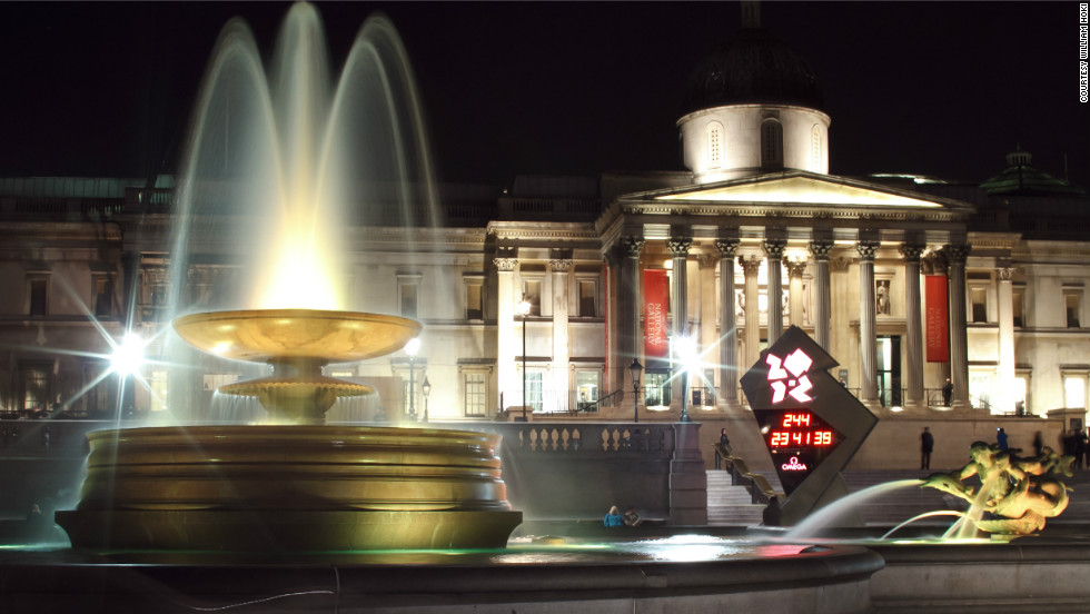 "William Hoki took this photo of the National Gallery, including the 2012 Olympic countdown clock in the frame. ""The fountains at Trafalgar Square were recently restored with LED lights that gradually change colors. It's an amazing spectacle at night."""