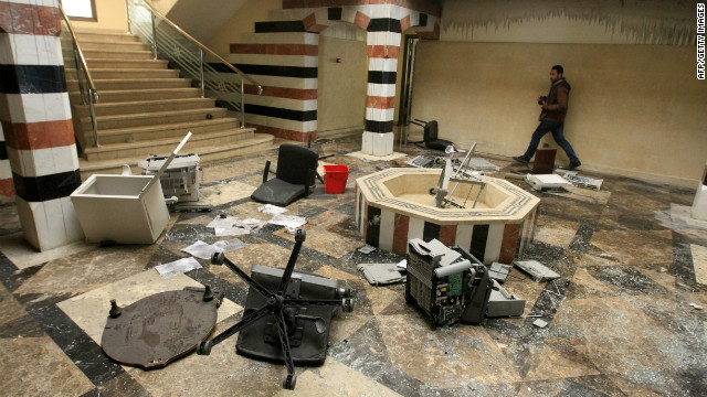 A photographer walks in the damaged reception hall of the Syrian embassy in Cairo, Egypt on February 4, 2012.