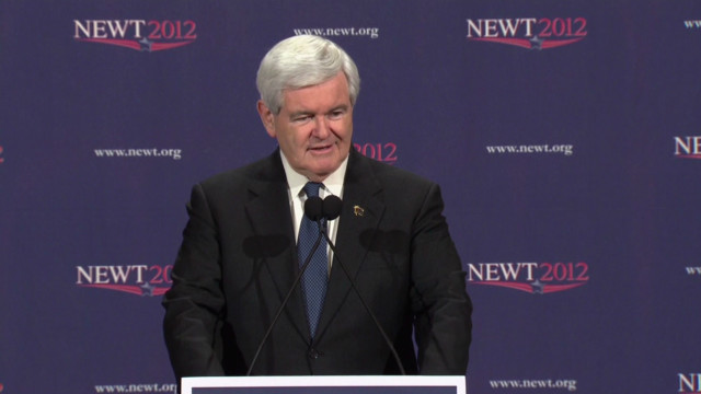 Gingrich vows to continue to convention