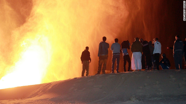 Onlookers stand in front of a fire ball following an attack on a gas pipeline in northern Sinai on February 5.