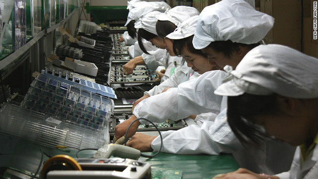 Workers on a production line at Foxconn's Longhua plant, which employs 300,000 people and makes products for Apple.