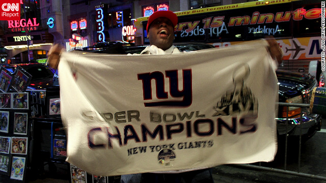 Fans in Times Square go crazy and celebrate the Giants' victory over the Patriots in Super Bowl XLVI on Feb. 5.