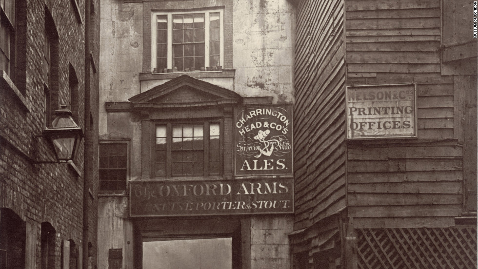 "The Oxford Arms inn, demolished in 1876, was typical of the ""ancient hostelries"" that had ""degenerated into little more than the abiding and booking-places of country wagons,"" according to Dickens."