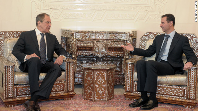 Syria's President Bashar al-Assad (R) speaks with visiting Russia's Foreign Minister Sergei Lavrov during their meeting at the presidential palace in Damascus, on February 7, 2012. Lavrov's trip comes days after Russia disgusted the West and Syrian opposition activists by vetoing along with China a UN Security Council resolution condemning the Assad regime's crackdown on protesters. AFP PHOTO / POOL (Photo credit should read STR/AFP/Getty Images)