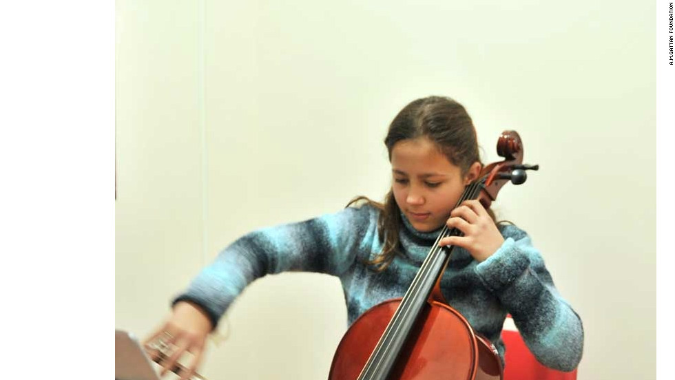 A cello student  practising. Cello is one of the Western Classical instrument taught at Gaza Music School.