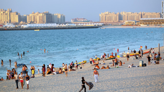 People relax at Jumeirah beach in Dubai, United Arab Emirates, an area of calm in an often troubled region.