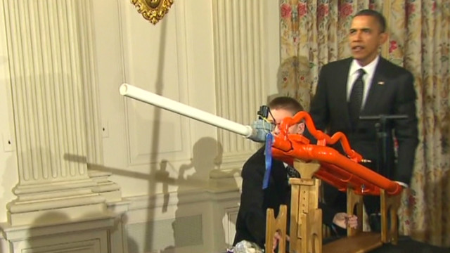 Obama helps fire marshmallow gun