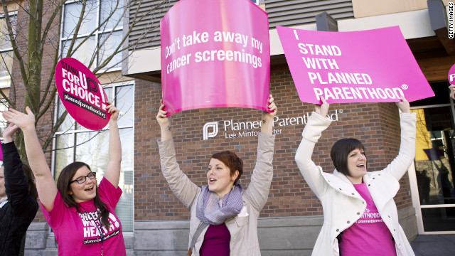 Protesters hold up signs following a press conference by U.S. Sen. Patty Murray outside at a Planned Parenthood Clinic Feb. 3