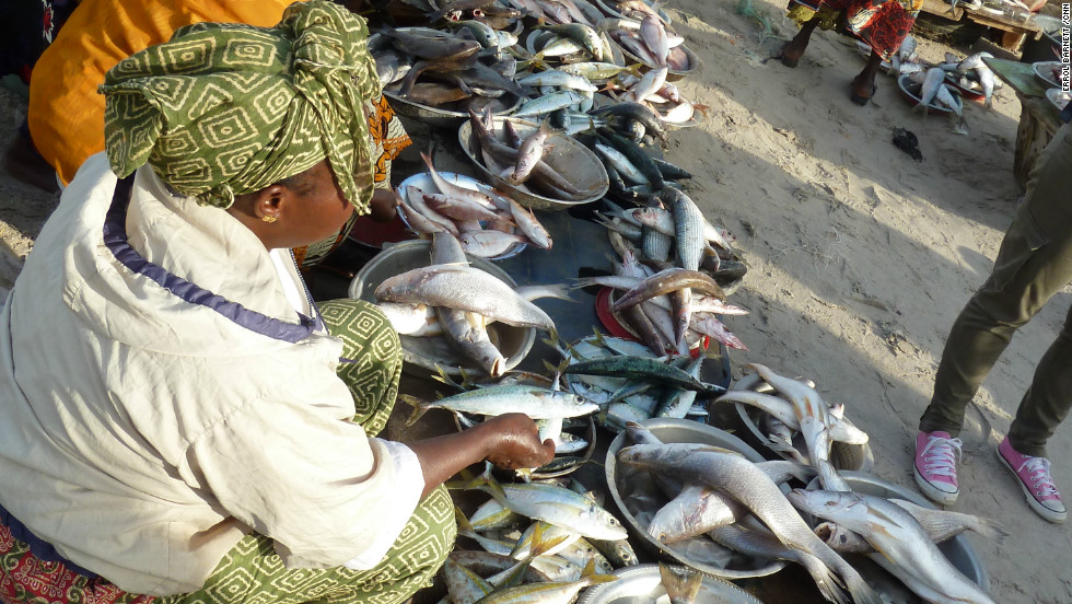 """Wives of fisherman act as """"brokers"""" helping them sell to local vendors."""