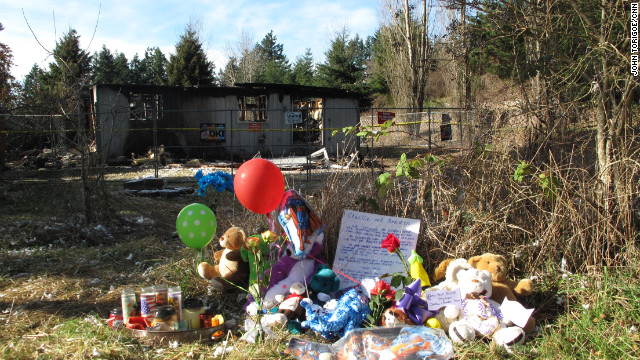 Makeshift memorials surround the Washington state home of Josh Powell who took his own life and the lives of his young sons, Charlie and Brayden.