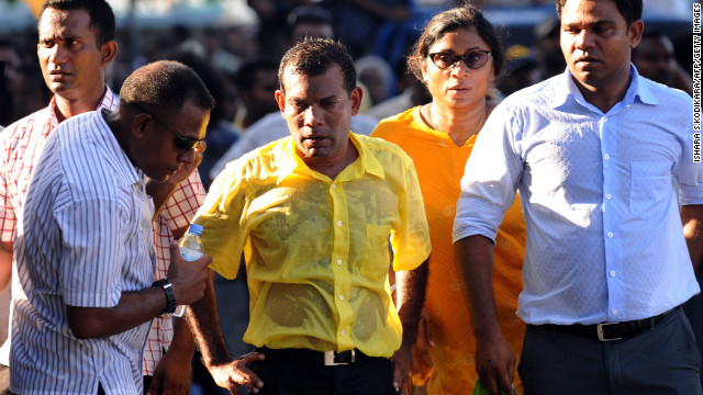Former Maldivian president Mohamed Nasheed, center, is soaked in sweat in a street protest in the capital Male on February 8.