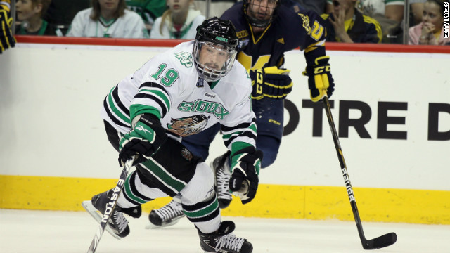 Evan Trupp of the North Dakota Fighting Sioux tries to keep the puck in a game against the Michigan Wolverines on April 7, 2011.