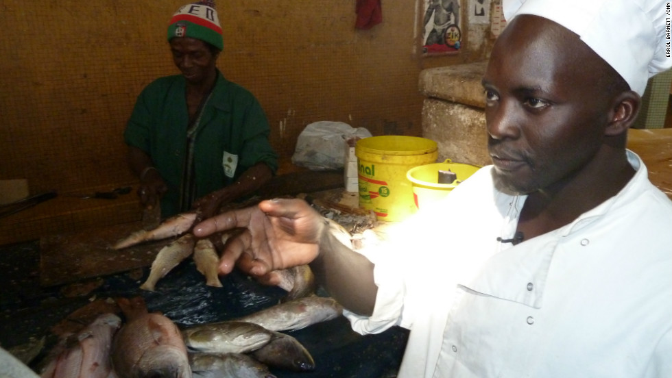 "Chef Ishmail N'Dour purchases fish, a key component of ""Thiebou Jen,"" the national dish."