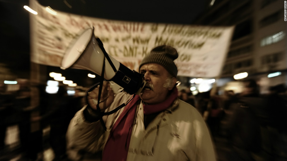 A protester shouts slogans in front of the parliament during a demonstration in Athens on February 9, 2012. Greece's main unions  called a 48-hour strike, the second this week, over new austerity cuts agreed by the country's coalition government in return for bailout loans.