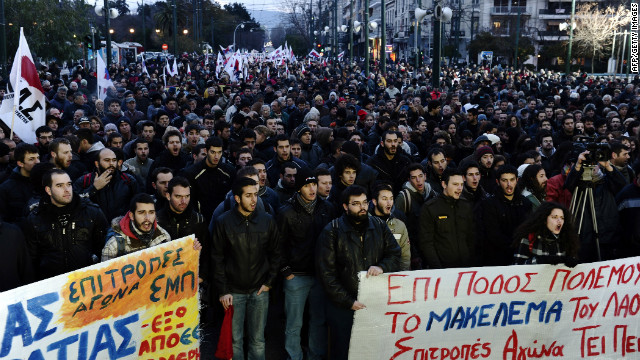 Protesters shout slogans during a demonstration in Athens on February 9, 2012. Greece's main unions today called a 48-hour strike, the second this week, over new austerity cuts agreed by the country's coalition government in return for bailout loans. AFP PHOTO/ ARIS MESSINIS (Photo credit should read ARIS MESSINIS/AFP/Getty Images)