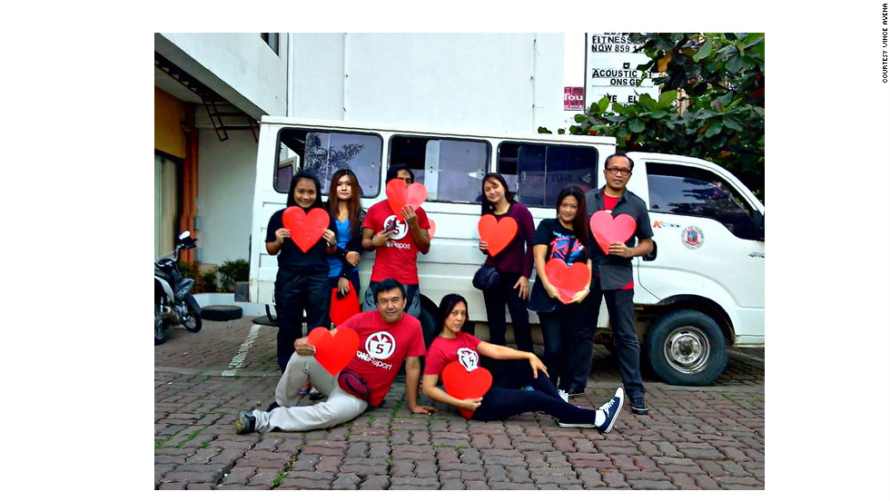 "iReporter Vince Avena (far right) joined fellow humanitarians to form Operation VALENTINES. Members of the group left their hometown outside Manila, Philippines, and traveled nearly 1,000 kilometers (621 miles) south to Barangay Mandulog to help residents still recovering from Typhoon Sendong. ""We do what we can with what we have,"" Avena said. ""That's way better than doing nothing at all."" Others in the group are (seated) Andrew Go and Lia Ocampo, and (standing, from left) Natrisha Navarro, Natasha Navarro, Sherbien Dacalanio, Veronica Lon and Shine Antonio."