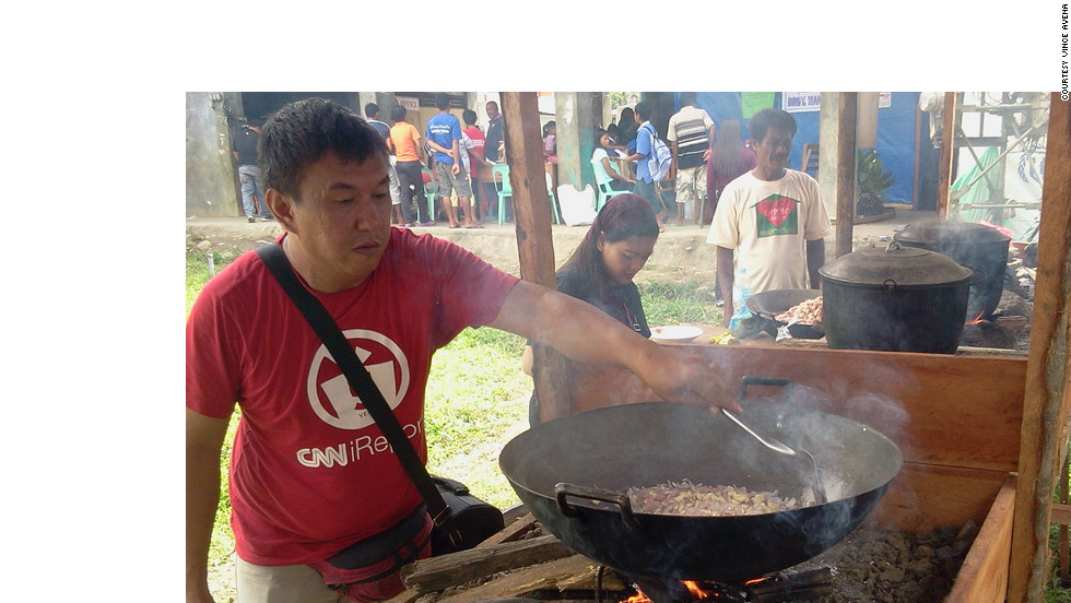 "iReporter Andrew Go prepares chicken soup for children in the resettlement area of Mandulog, Iligan. ""Of all the things we bring with us, there is one thing we hope to bring to the people that would stay with them: hope,"" fellow iReporter Vince Avena said. ""It's not something we can pack in a box, not something that we can weigh or put a price tag on. It is in showing them that in their suffering and pain, they are not alone; that there will always be people -- ordinary folks -- who, when given the chance, can do a little something to make a difference in someone else's life."""