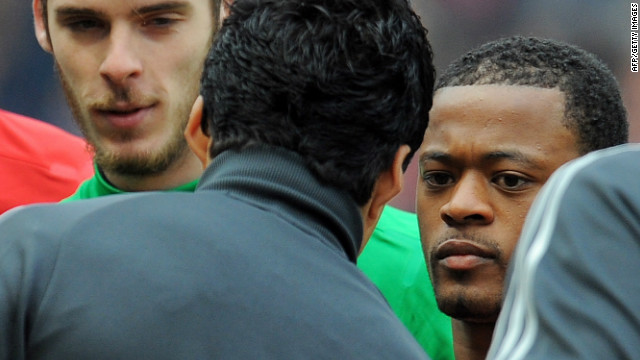 Patrice Evra and Luis Suarez (second left) fail to shake hands before the start of an English Premier League game.