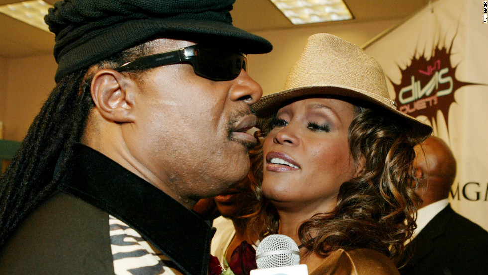 "Stevie Wonder and Whitney Houston meet backstage during ""The VH1 Divas Duets"" concert to benefit the VH1 Save the Music Foundation in Las Vegas in May 2005."