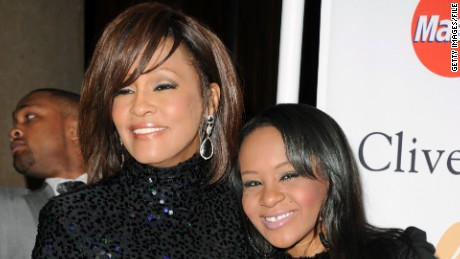 Whitney Houston, left, and Bobbi Kristina Brown arrive at a pre-Grammy event in February 2011 in Beverly Hills, California.