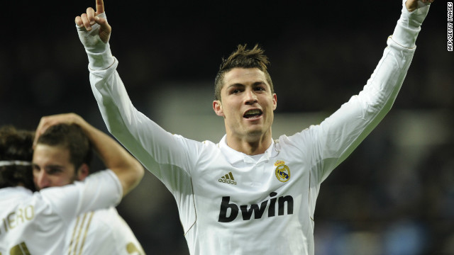 Cristiano Ronado celebrates on his way to a hat-trick in the Santiago Bernabeu stadium.